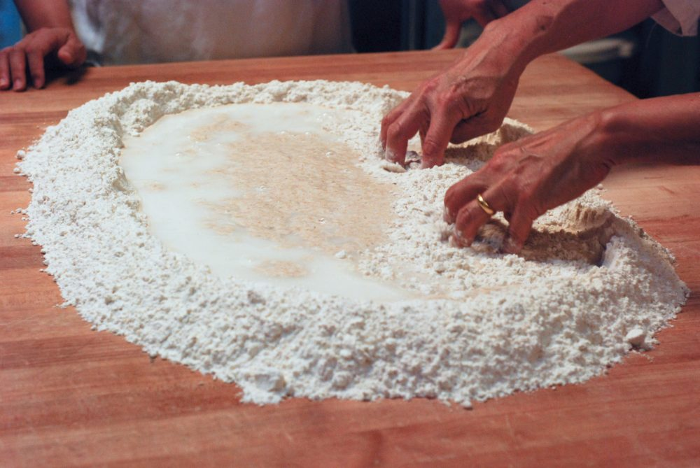 Then we mix in the water into our flour mix
