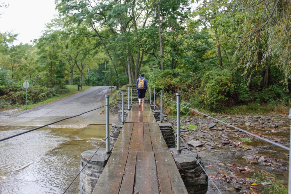 Ben is just walking across this rickety bridge like nothing is wrong